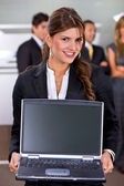 Business woman with a laptop — Stockfoto