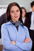 Arms crossed businesswoman — Stock Photo