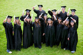 Happy graduation students — Stock Photo