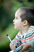 Lovely child writing — Stock Photo