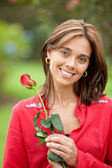 Woman with a rose — Stock Photo