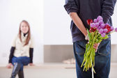 Man with flowers — Stock Photo