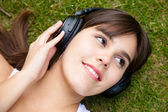 Woman listening music — Stock Photo