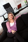 Business woman on the couch — Stock Photo