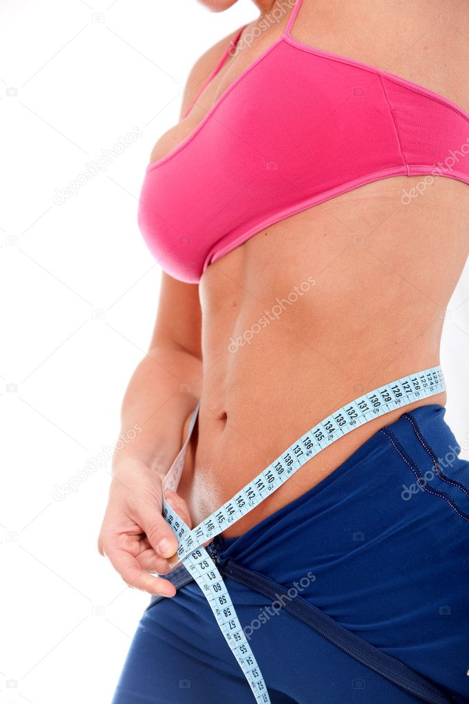 Girl measuring her waist checking if she has had any weight loss - isolated over a white background — Stock Photo #7701720