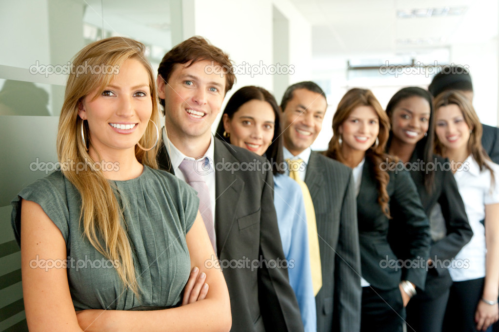 Group of business smiling in an office lined up — Stock Photo #7701775