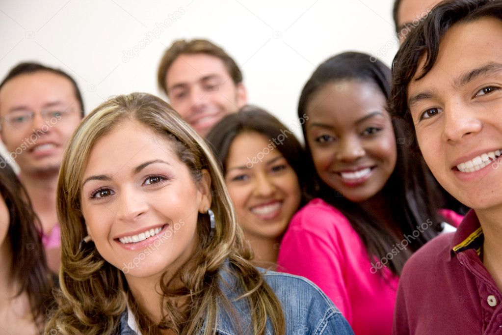 Multi-ethnic group of university students smiling in a classroom — Stock Photo #7701815