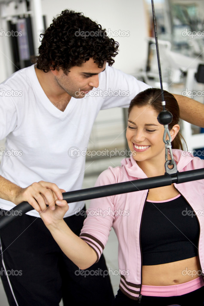 Gym woman and her trainer doing exercise at the gym — Stock Photo #7704092