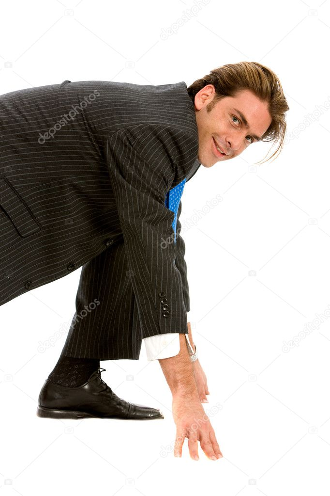 Business man ready to race  isolated over a white background  Stock Photo #7704372