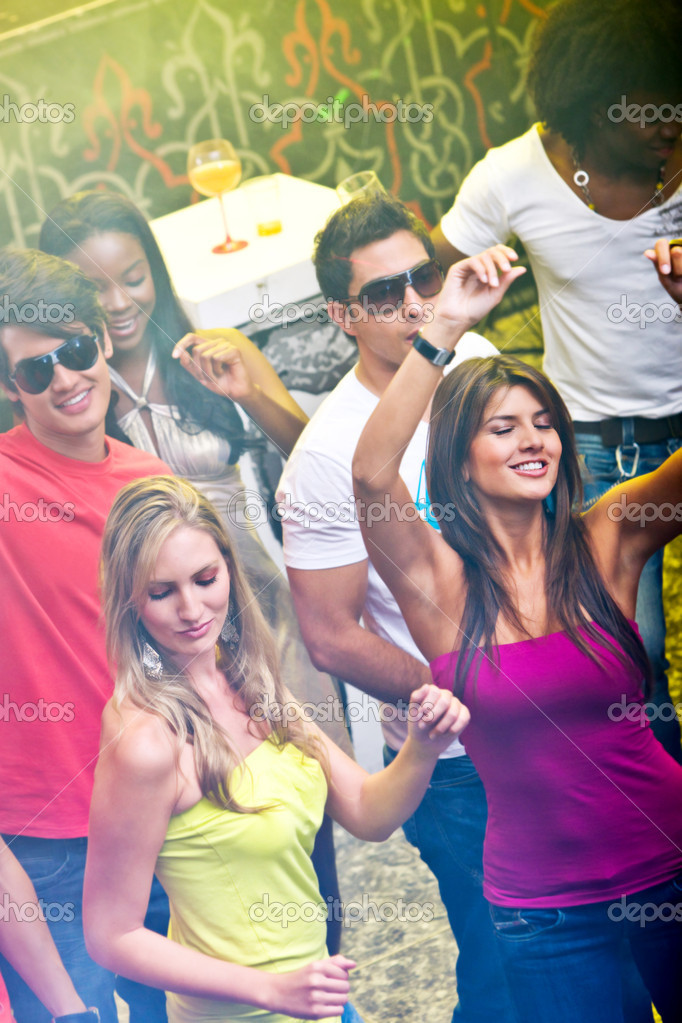 Group of happy friends smiling in a bar or a nightclub  Stock Photo #7704416