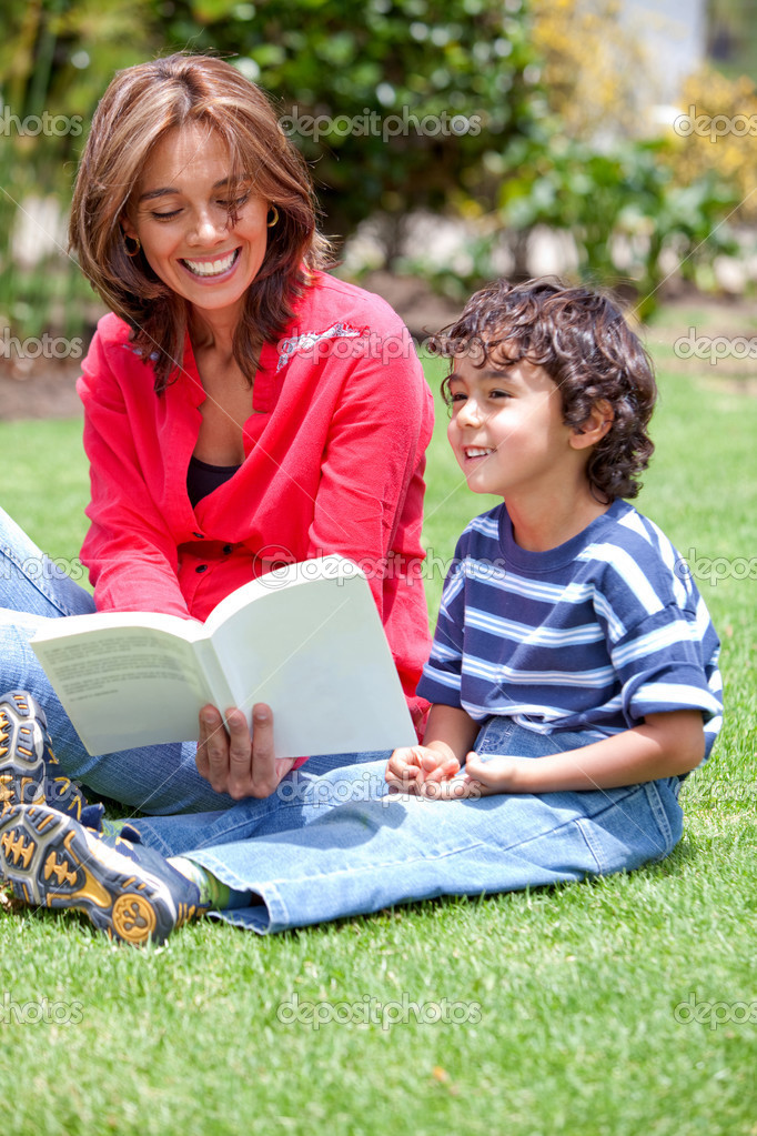 Mother and son reading a book together outdoors  Stock Photo #7704842