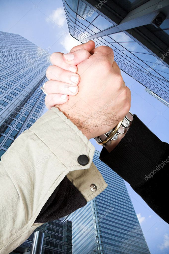 Informal handshake over financial buildings — Stock Photo #7705048