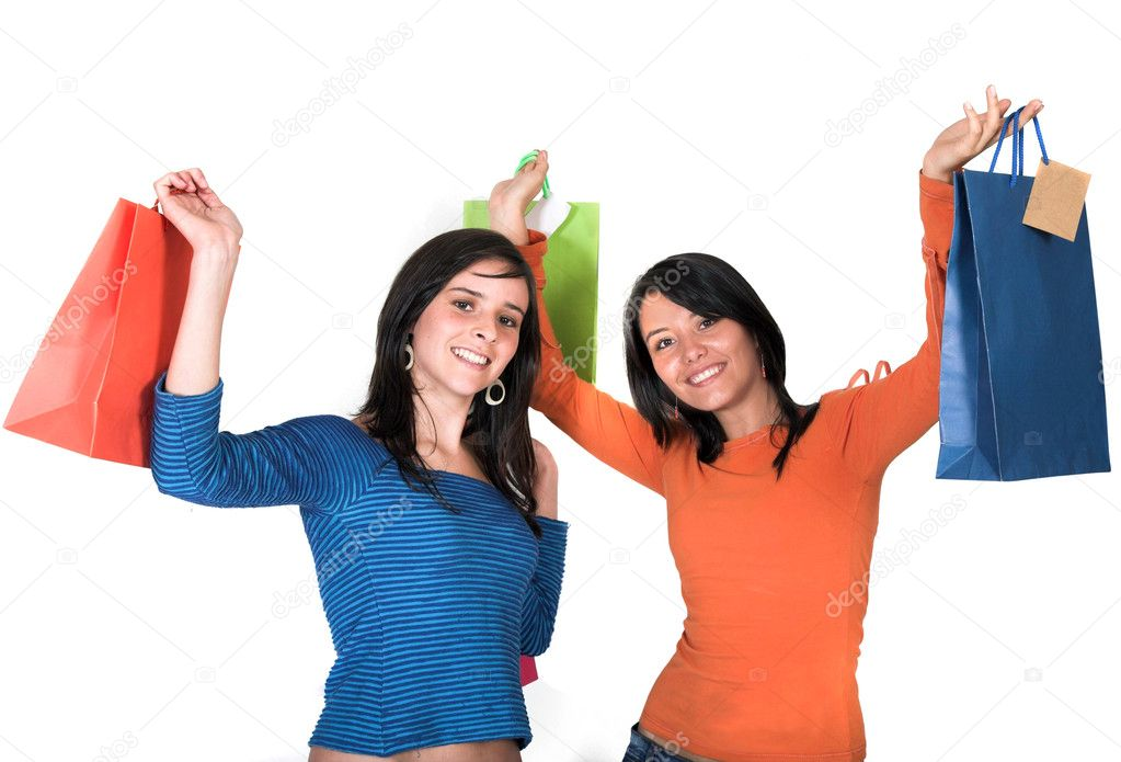 Beautiful teenagers with shopping bags over white — Stock Photo #7705804
