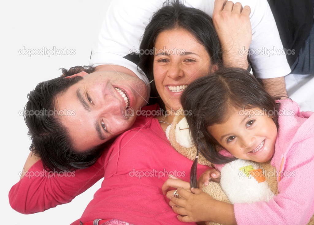 Happy latin american family over a white background  Stock Photo #7705909