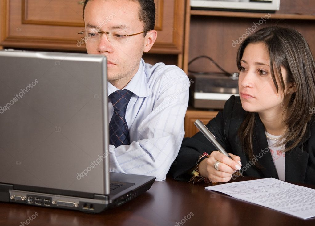 Business partners on a laptop in their office — Stock Photo #7706379