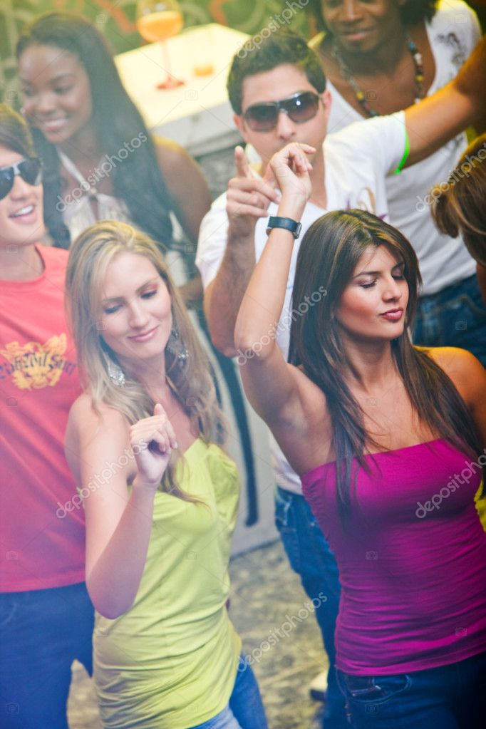 Beautiful girls clubbing at a disco  Stock Photo #7707420