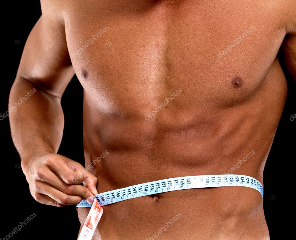Man with a muscular body measuring his abs - lose weight series  Stock Photo #7707604