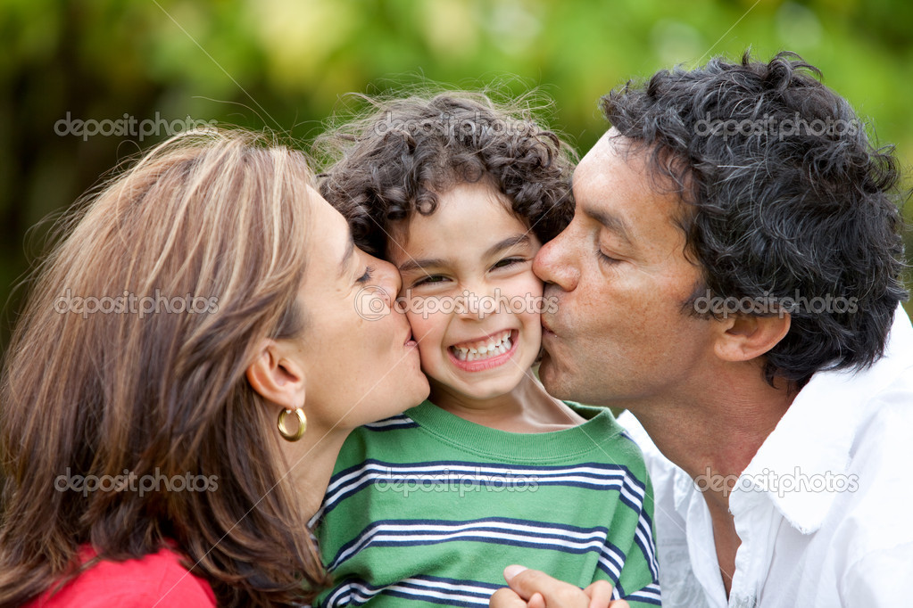 Parents proud of his son give him a kiss  Stock Photo #7708110
