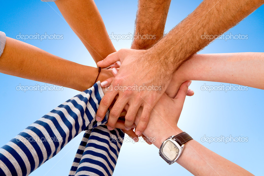 Teamwork with hands together over a blue background — Stock Photo #7708578