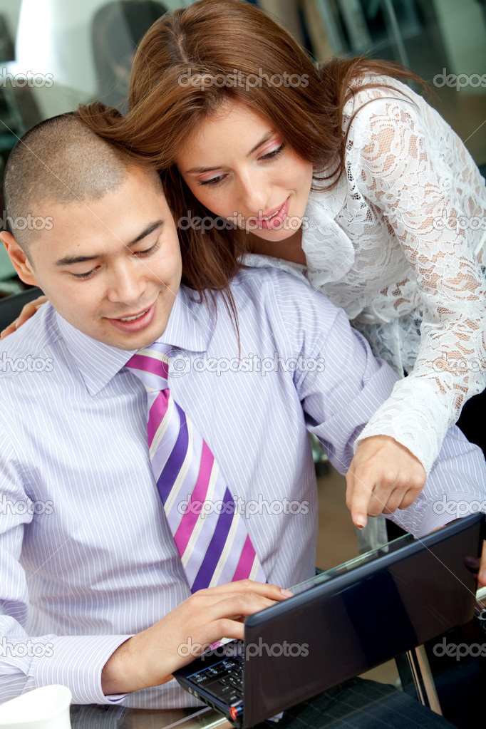 Business couple working on a laptop in an office — Stock Photo #7709367