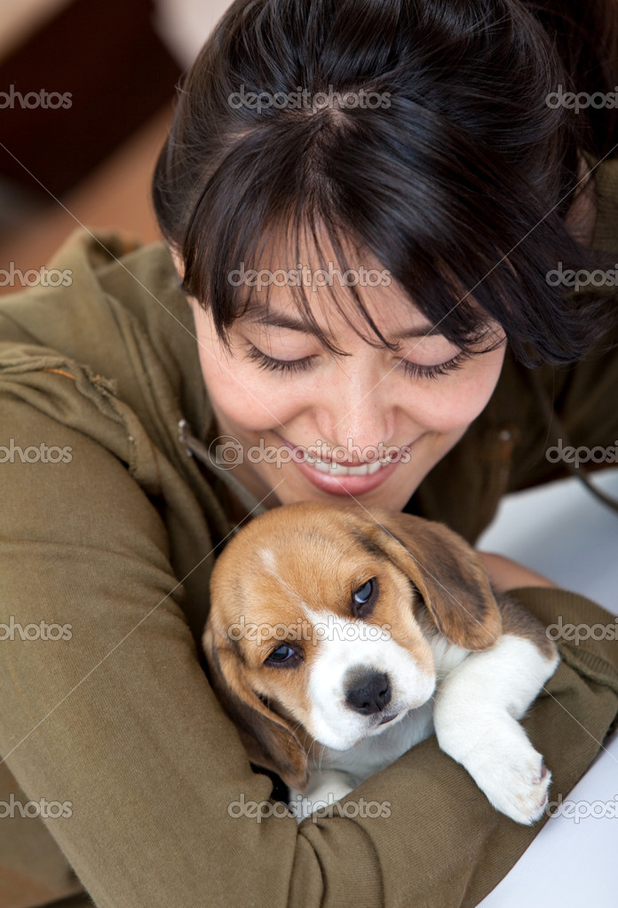 Beautiful girl with a cute little puppy  Stock Photo #7709637