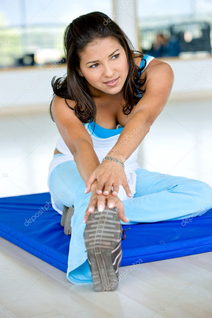 Beautiful woman at the gym stretching her legs — Stock Photo #7709732