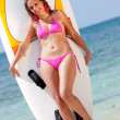 Bikini woman with surfboard - Stock Photo