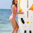 Woman with a surfboard - Stock Photo