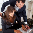 Business couple on a laptop — Stock Photo #7710048
