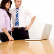 Business couple on a laptop — Stock Photo #7710128