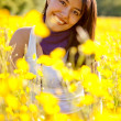 Casual woman smiling outdoors — Stock Photo