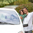Father and son getting into ther car — Stock Photo