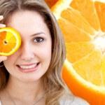 Woman with an orange — Stock Photo #7710308