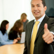 Thumbs up businessman — Stock Photo