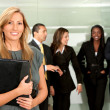 Business woman and team — Stock Photo #7710401