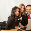 Business team with laptop — Stock Photo #7710434