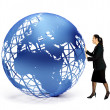 Stock Photo: Business woman with a globe