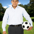 Man with a football outdoors — Stock Photo
