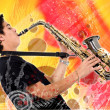 Guy playing the saxophone - Stock Photo