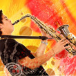 Stock Photo: Guy playing the saxophone