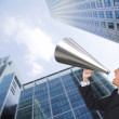 Business man with megaphone — Stock Photo