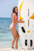 Woman with a surfboard — Stock Photo