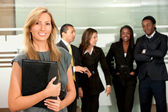 Business woman and team — Stock Photo
