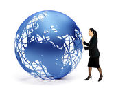 Business woman with a globe — Stock Photo
