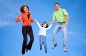 Family on the skies — Stock Photo