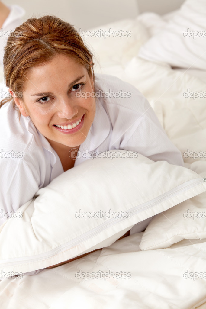 Beautiful woman in bed with a pillow — Stock Photo #7710064