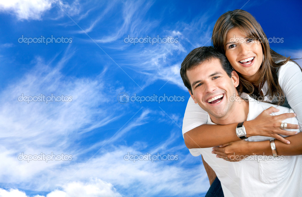 Beautiful happy couple smiling with a blue sky  Stock Photo #7710273