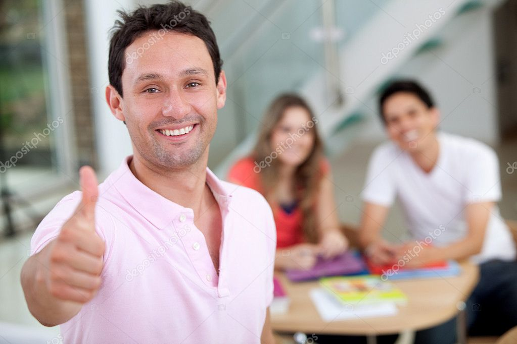 Casual smiley man with thumbs up indoors — Stock Photo #7710597