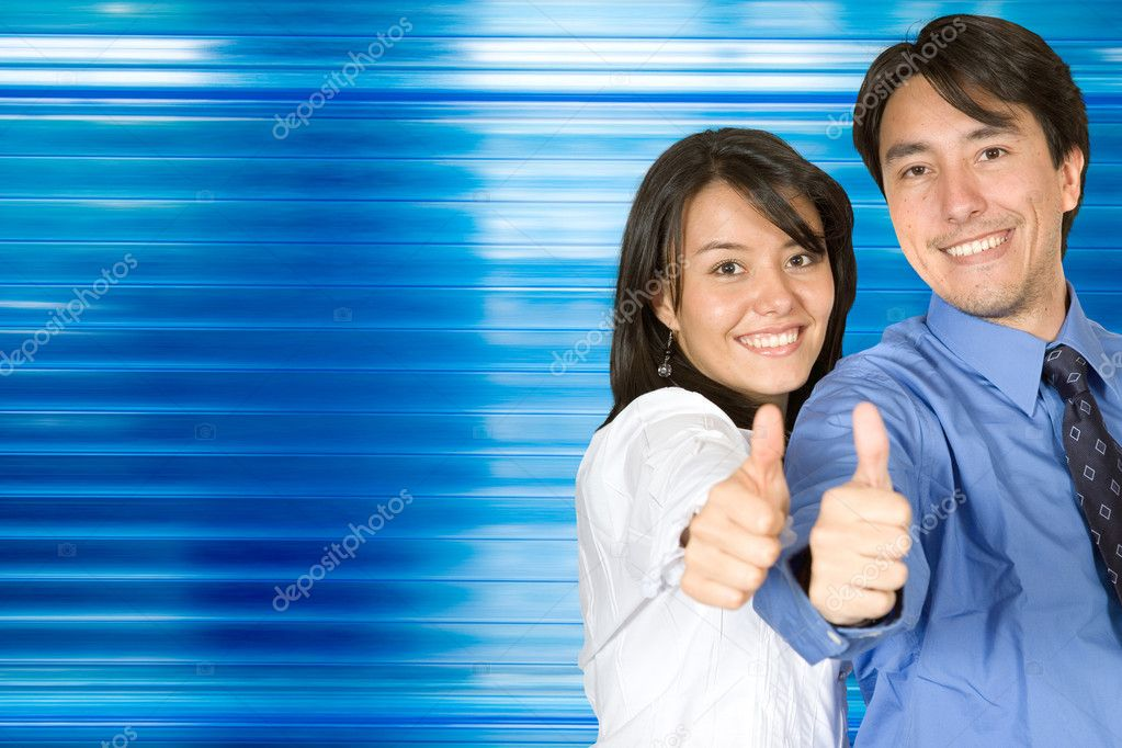 Business couple with their thumbs up over a blue background — Stock Photo #7710745