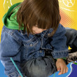 Boy colouring on notebook — Stock Photo #7730705